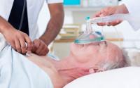 Doctors resuscitating a senior patient